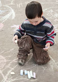 Child drawing with chalk. Child chalk drawing on the pavement outside Stock Photography