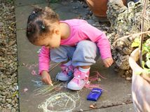 Child drawing with chalks Stock Photos