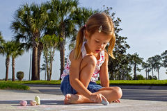 Child drawing with chalks Royalty Free Stock Photos