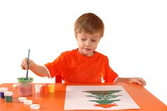 Child drawing a Christmas card Stock Image