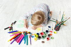 Child drawing color picture in album royalty free stock photo