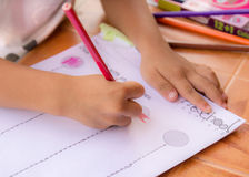 Child drawing with colorful pencils. Stock Photos