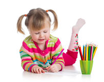 Child drawing with colourful pencils Stock Images