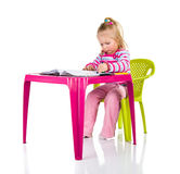 Child drawing with crayons Stock Photos