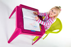 Child drawing with crayons Royalty Free Stock Photography