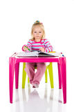 Child drawing with crayons Royalty Free Stock Images