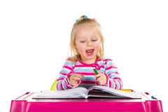 Child drawing with crayons Stock Image