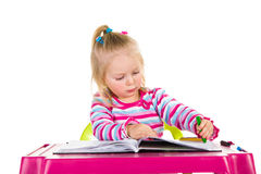 Child drawing with crayons Stock Images