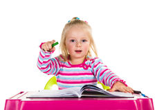 Child drawing with crayons Royalty Free Stock Photo