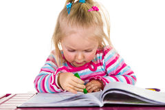 Child drawing with crayons Royalty Free Stock Photos