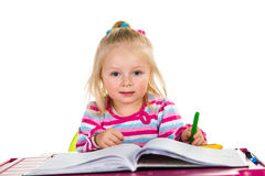 Child drawing with crayons Royalty Free Stock Image