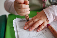 Child drawing with crayons. On a piece of paper stock photos