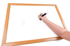 Child drawing on a dry erase board Stock Image