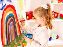 Child drawing on the easel. Child drawing on the easel at school stock photo