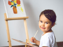 Child drawing on the easel isolated. Child drawing on the easel stock image