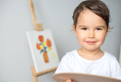 Child drawing on the easel isolated. Child drawing on the easel royalty free stock images
