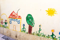 Child Drawing on Exterior Wall Outdoor Chalk Sun House Tree Scen Stock Photo