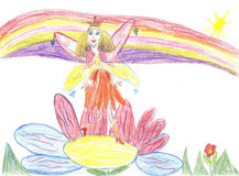 Child drawing fairy flying on a flower Stock Photography
