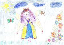 Child drawing fairy flying on a flower Stock Photos