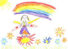 Child drawing fairy flying on a flower Stock Image