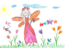 Child drawing fairy flying on a flower Stock Photo