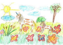 Child drawing of a fairy tale unicorns grazing on the meadow Stock Image