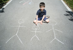 Child drawing family on asphalt Stock Photography
