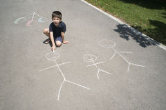 Child drawing family on asphalt Royalty Free Stock Photos