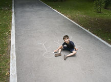 Child drawing family on asphalt Royalty Free Stock Photography