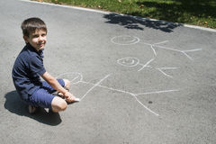 Child drawing family on asphalt Stock Photo