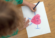 Child drawing. Royalty Free Stock Photography