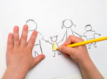 Child drawing happy family, metaphor for full family and happine Stock Photo