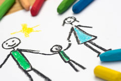Child drawing, happy family , selective focus. Child crayon drawing, happy family , selective focus royalty free stock photos