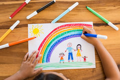 Child drawing happy family royalty free stock image