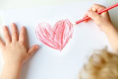 Child drawing a heart Royalty Free Stock Photography