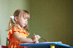 Child drawing at home Stock Image