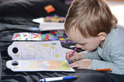 Child drawing  at home Stock Photography