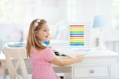 Child drawing. Kids paint. Girl after school royalty free stock photography