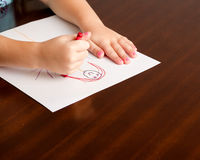 Child drawing a little person Royalty Free Stock Photos