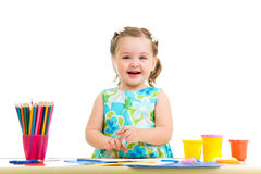Child drawing and making by hands. Child girl drawing and making by hands royalty free stock image