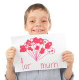 Child with drawing for mum Royalty Free Stock Photography