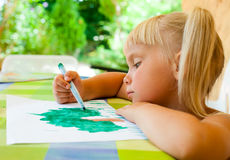 Child drawing outdoors Royalty Free Stock Photography