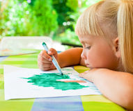 Child drawing outdoors Stock Images