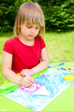 Child drawing outdoors Stock Image