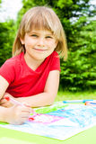 Child drawing outdoors Royalty Free Stock Photos