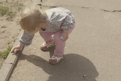 Child drawing on the pavement border Stock Photo
