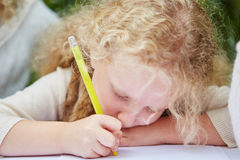 Child drawing with pen Royalty Free Stock Photos