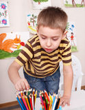 Child drawing pencil in play room. Royalty Free Stock Photos