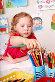 Child drawing pencil in play room. Stock Images