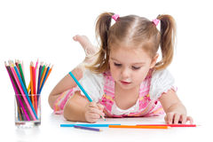 Child drawing with pencils. Cute child drawing with colorful pencils stock image